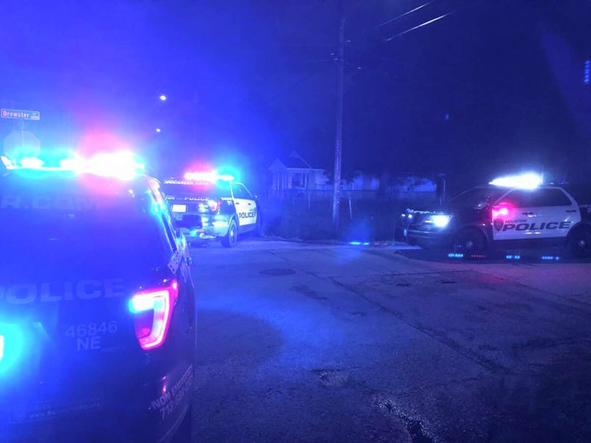 Two suspects were apprehended after a shot was fired at Houston police officers in an unmarked car on Friday night, according to authorities.