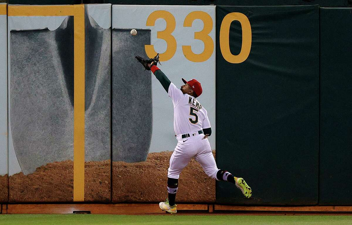 OAKLAND, CALIFORNIA - JULY 02: Tony Kemp #5 of the Oakland Athletics catches a ball hit by Enrique Hernandez #5 of the Boston Red Sox in the seventh inning at RingCentral Coliseum on July 02, 2021 in Oakland, California. (Photo by Ezra Shaw/Getty Images)