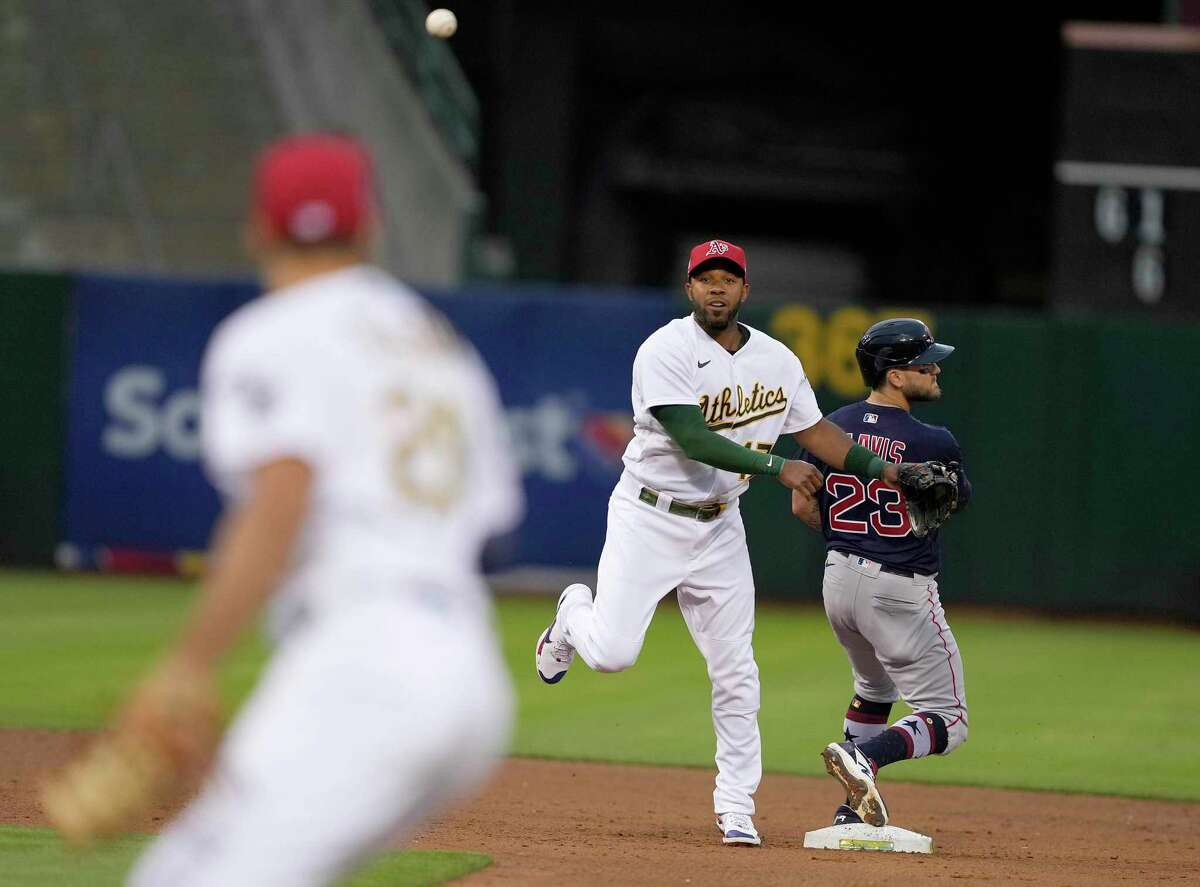 Oakland Athletics shortstop Elvis Andrus (17) throws to first after forcing out Boston Red Sox's Michael Chavis (23) at second base during the the fifth inning of a baseball game Friday, July 2, 2021, in Oakland, Calif. Enrique Hernandez was out at first. (AP Photo/Tony Avelar)