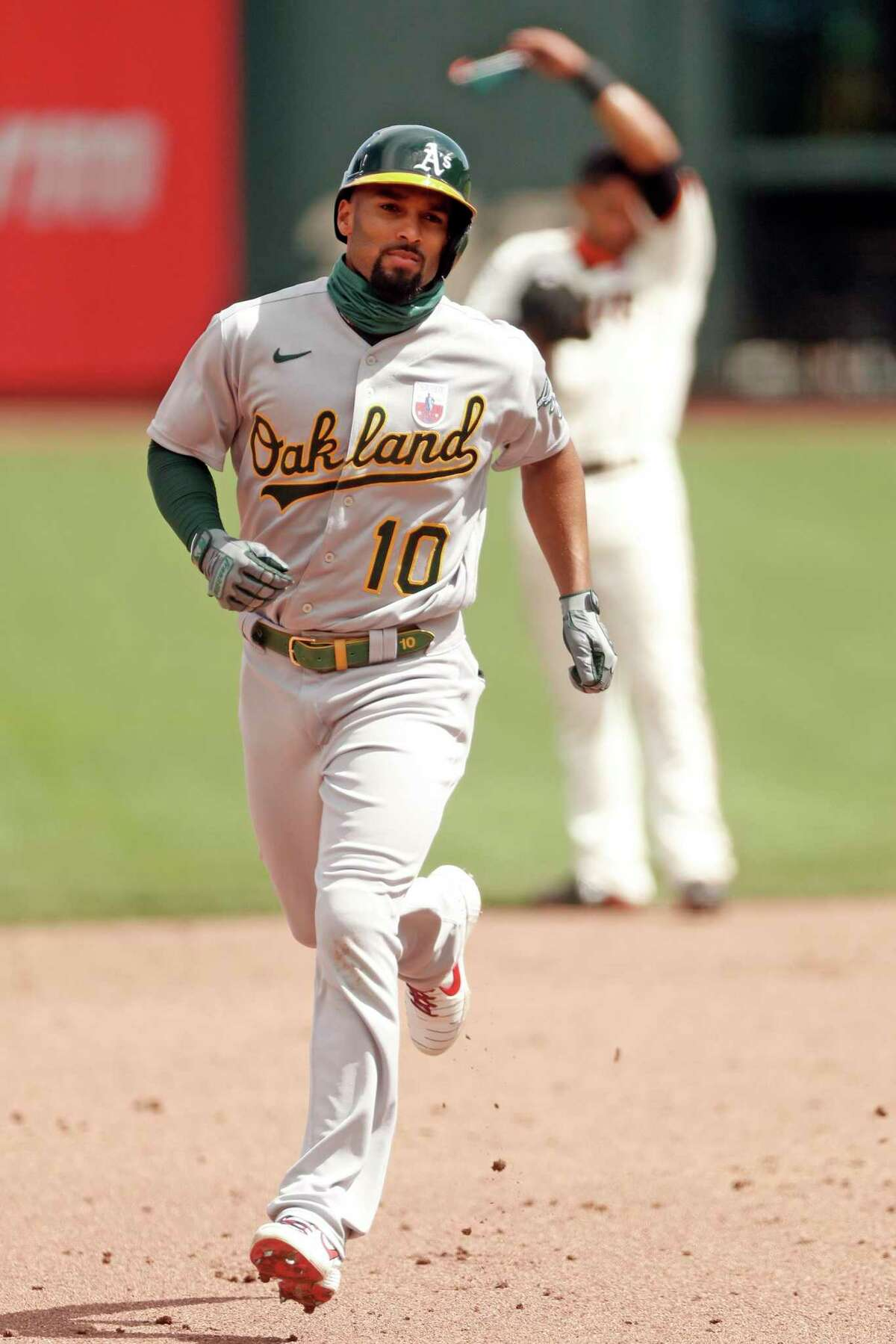 Oakland Athletics' Marcus Semien rounds the bases after his 2-run home run during A's 9-run 5th inning against San Francisco Giants during MLB game at Oracle Park in San Francisco, Calif., on Sunday, August 16, 2020.