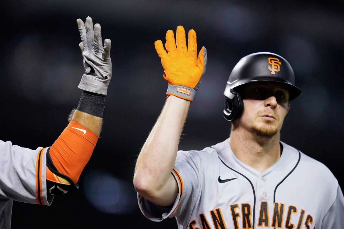 San Francisco Giants' Alex Dickerson celebrates his home run against the Arizona Diamondbacks during the third inning of a baseball game Friday, July 2, 2021, in Phoenix. (AP Photo/Ross D. Franklin)