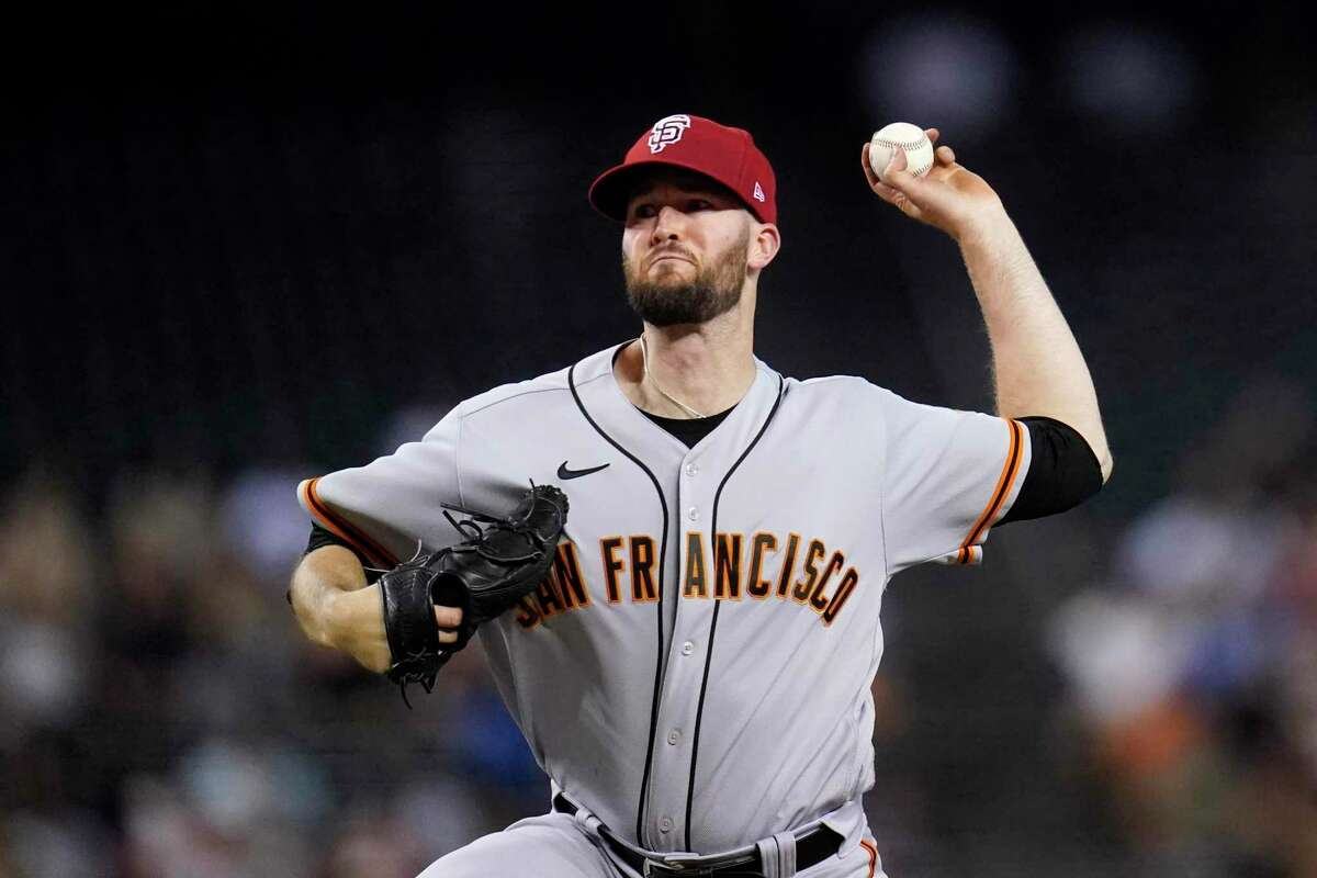 San Francisco Giants starting pitcher Alex Wood throws against the Arizona Diamondbacks during the first inning of a baseball game Friday, July 2, 2021, in Phoenix. (AP Photo/Ross D. Franklin)