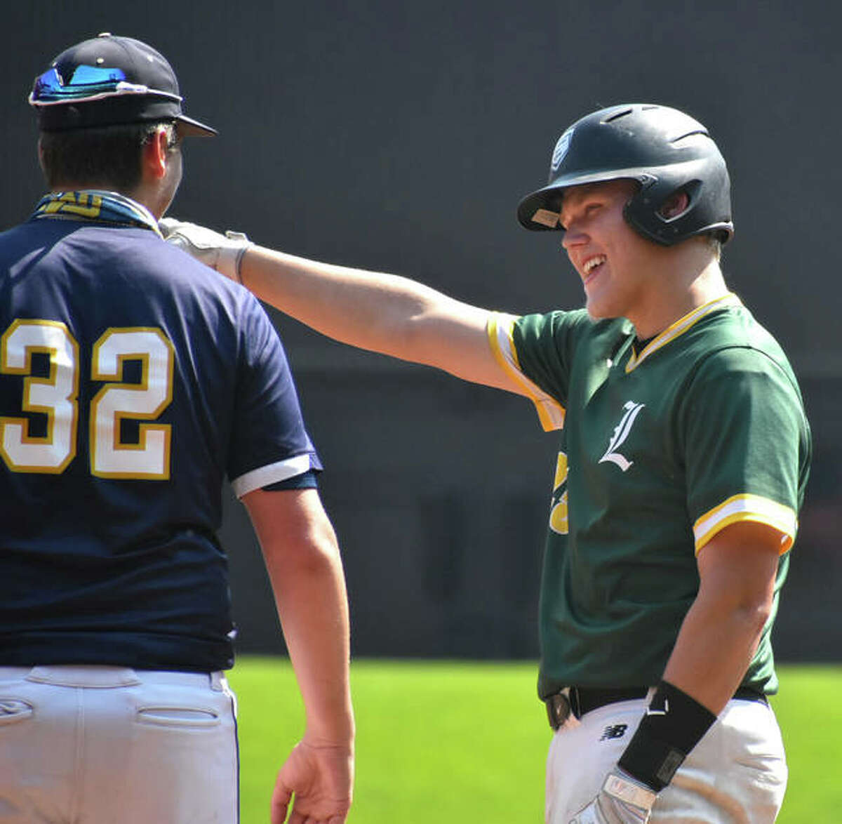Metro-East Lutheran's Erik Broekemeier is all smiles after reaching first base on a single against Father McGivney at Busch Stadium.