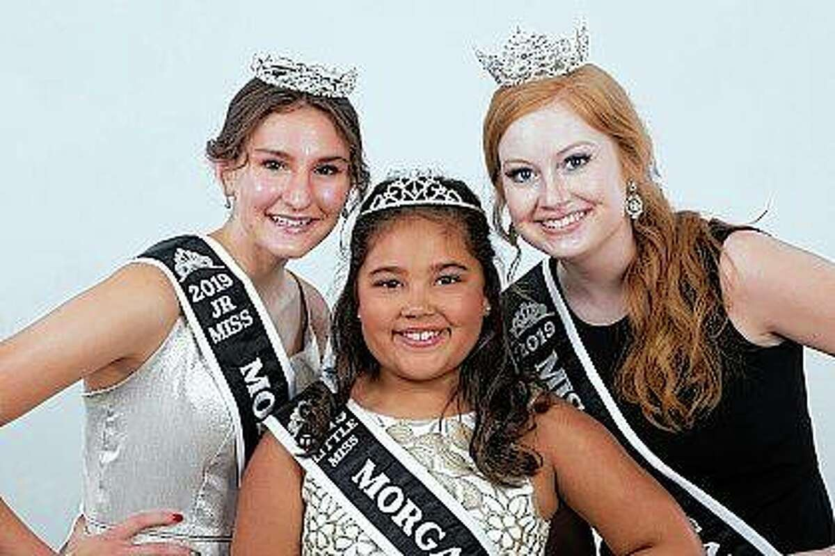 The reigning title holders for Morgan County Fair's three pageants are Miss Morgan County Lori Jackson (right), Junior Miss Kayla Brackett (left) and Little Miss Aleah Walls. After a two-year reign - the 2020 pageants were canceled by the COVID-19 pandemic - the three are preparing to relinquish their titles.