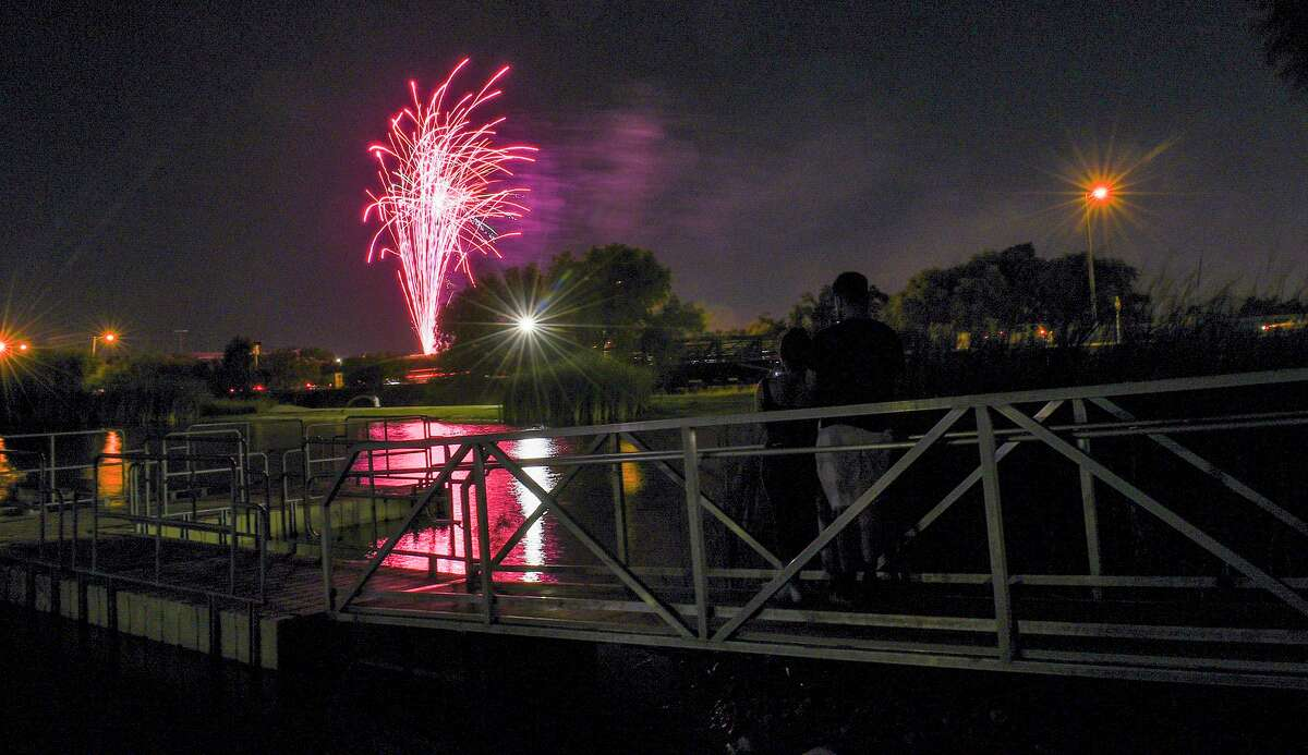 Laredoans watch the fireworks from Detention Pond Saturday, Jul 4, 2020 as part of the 4th of July festivities.