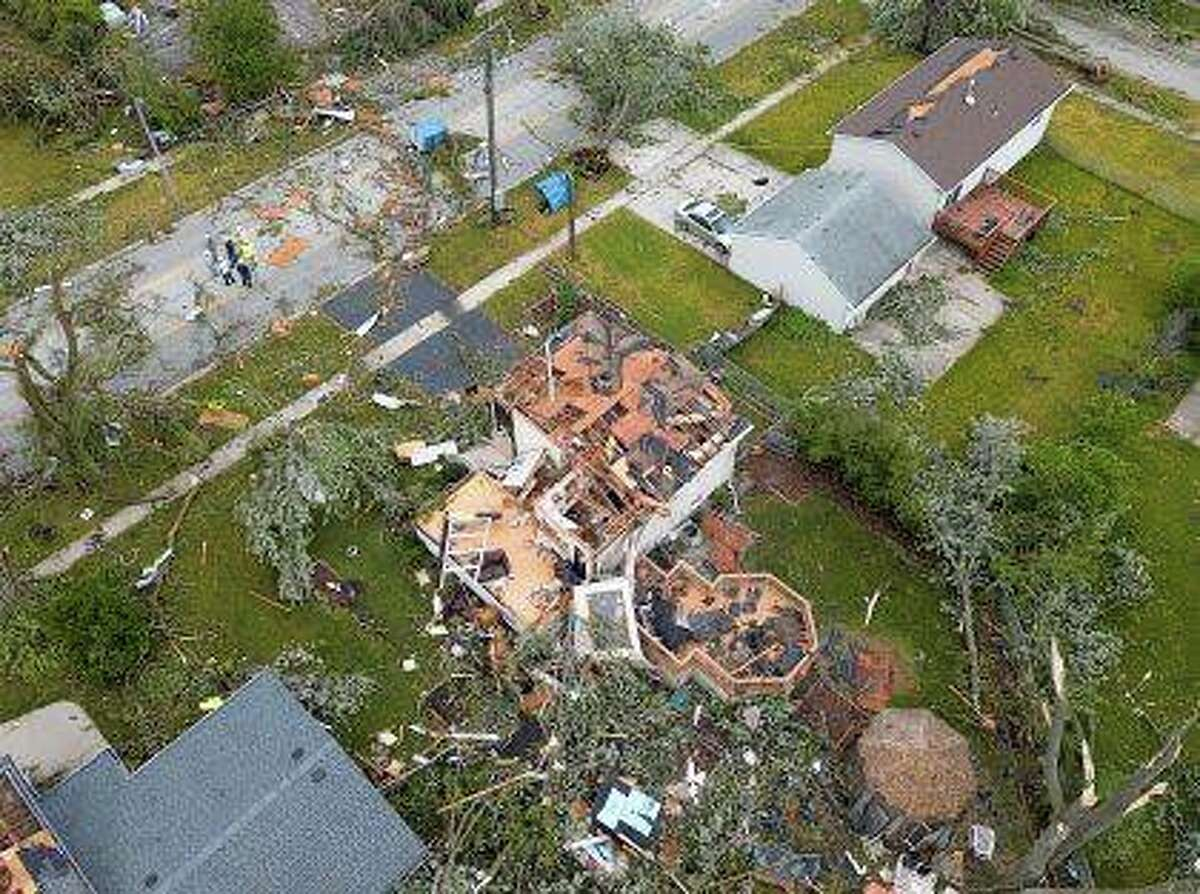 Tornado damage is visible after severe storms and a late-night tornado ripped through Naperville and Woodridge.