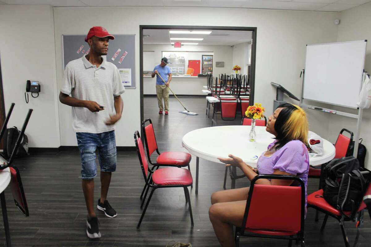 Manuel Johnson and his wife, Triena Johnson, wait for assistance in Hope Center Houston.