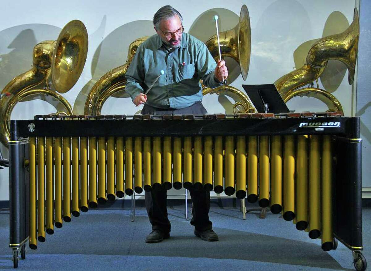 """Richard Albagli performs the marimba part from his ensemble work """"Harry's Final Journey"""" at a rehearsal room in RPI's West Hall in 2007. (John Carl D'Annibale / Times Union)"""