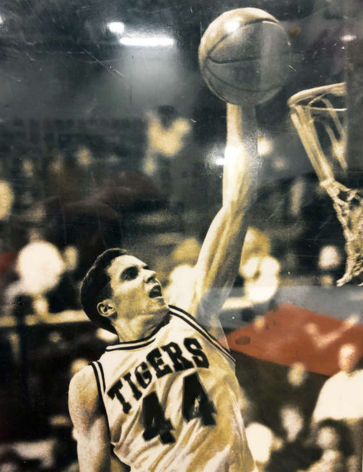 Joe Semith, a 1996 Edwardsville High School graduate, dunks the ball during his basketball playing days at EHS.