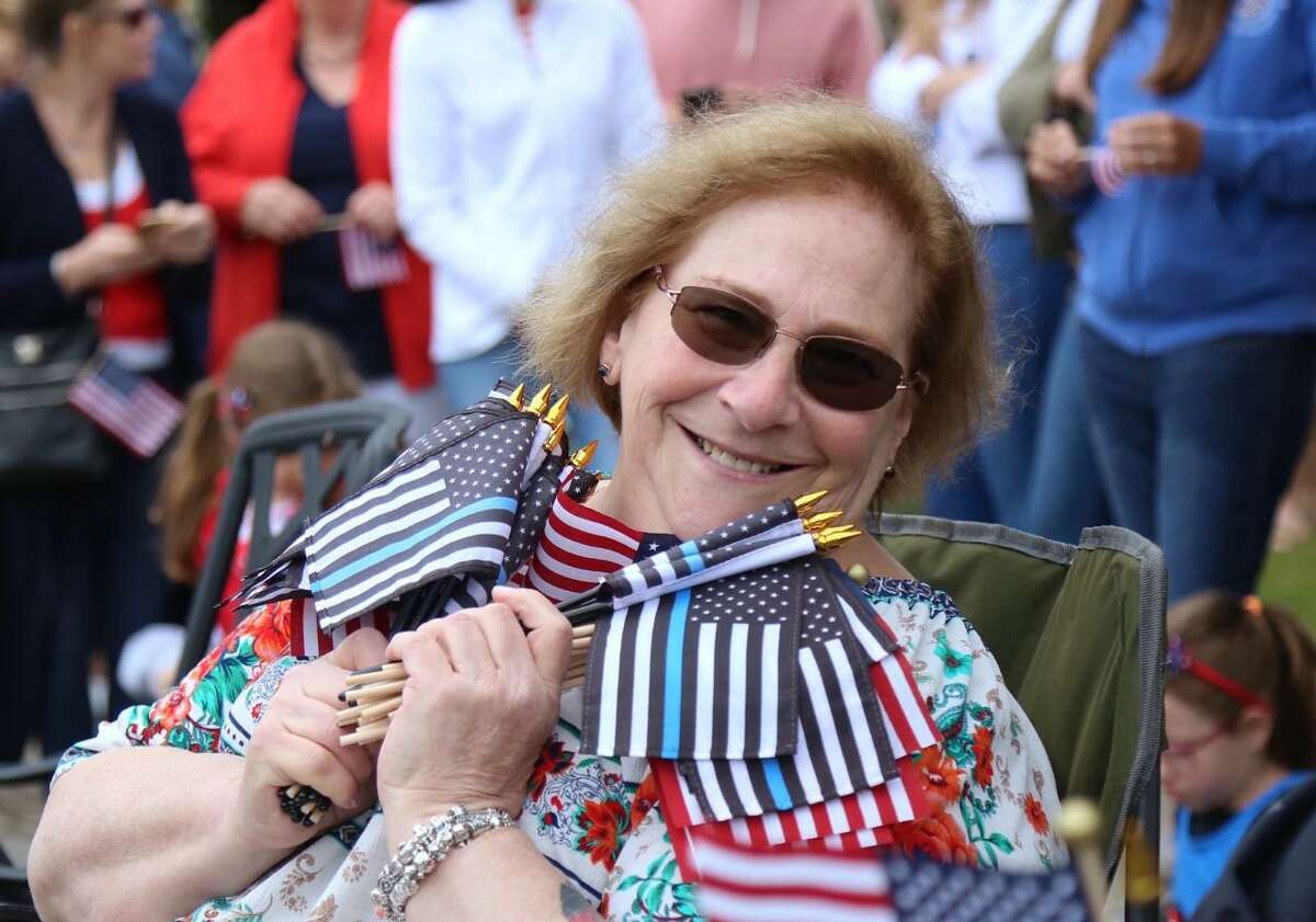 Janice Marzano, program director at The Depot, at the Memorial Day parade this year, where she helped distribute flags. Marzano has announced she will be retiring by year's end.