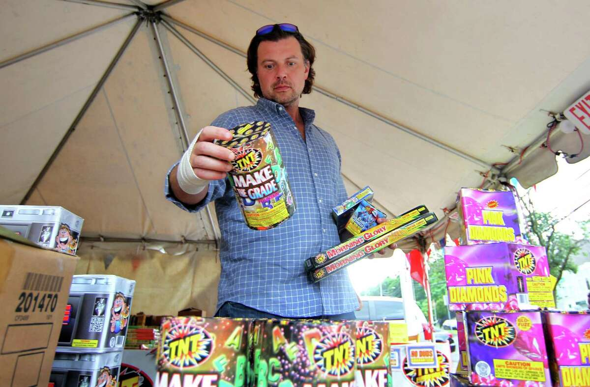 Stocking up for the July 4th holiday, Ryan Olmstead, of Katonah, buys fireworks at a TNT Fireworks tent setup at 1060 Long Ridge Road in Stamford, Conn., on Friday July 2, 2021.