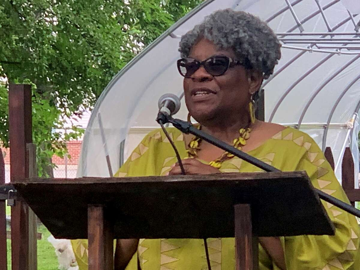 """Roxanne Booth, co-pastor of Riverview Baptist Church in Coeymans and adjunct professor in the Africana Studies Department at the University at Albany, speaks in the backyard of the Underground Railroad Education Center at the Stephen and Harriet Myers Residence in Albany during the center's annual July 4th Oration. The event commemorates abolitionist and social reformer Frederick Douglass' famous 1852 speech, """"What to the Slave is Your Fourth of July?"""" (Steve Barnes/Times Union.)"""