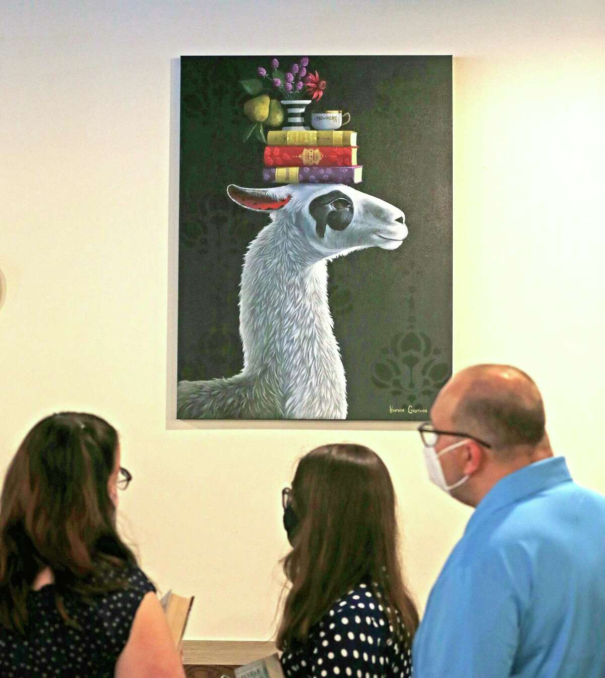 Guest at Nowhere Bookshop can observe many art works displayed at the first from-the-ground-up bookstore to open in San Antonio in decades and it hopes to attract crowds with a bar serving alcohol, dedicated areas for author appearances and plenty of reading nooks at Nowhere Bookshop 5154 Broadway on Saturday, June 26. 2021.
