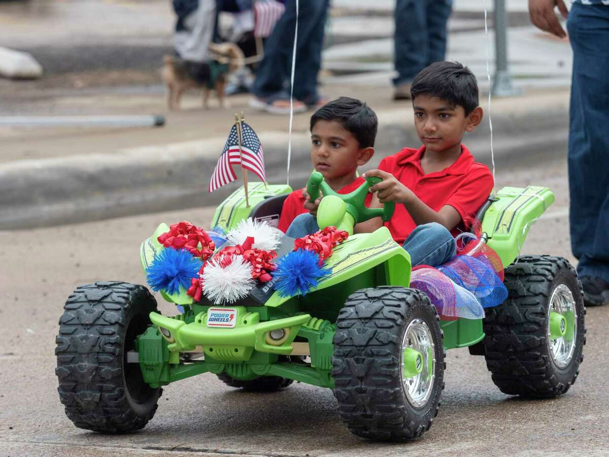 Children and families make their way through downtown Midland 07/03/2021 for the 58th annual Children's Parade in downtown Midland. Tim Fischer/Reporter-Telegram