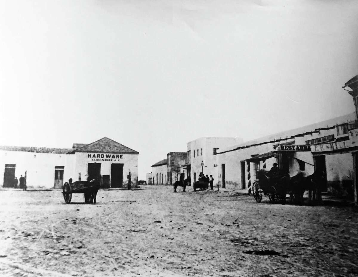 A post-Civil War view of Main Plaza shows the city's first hardware store, Elmendorff & Co., at left.