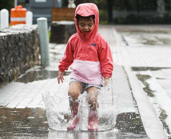 Fallon Jeansonne, 3, takes time to make the most out of her rain boots during Montgomery Freedom Fest, Saturday, July 3, 2021, in Montgomery. Photo: Jason Fochtman/Staff Photographer / 2021 © Houston Chronicle