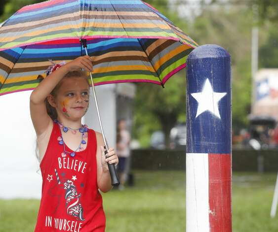 Levyn Marxs heads home after heavy rain sent vendors and visitors packing during Montgomery Freedom Fest, Saturday, July 3, 2021, in Montgomery. Photo: Jason Fochtman/Staff Photographer / 2021 ? Houston Chronicle