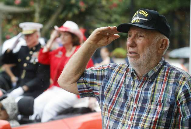 Navy veteran Randy Stephens salutes as the Star Spangled Banner plays during a Fourth of July parade at Market Street, Saturday, July 3, 2021, in The Woodlands. Photo: Jason Fochtman/Staff Photographer / 2021 © Houston Chronicle