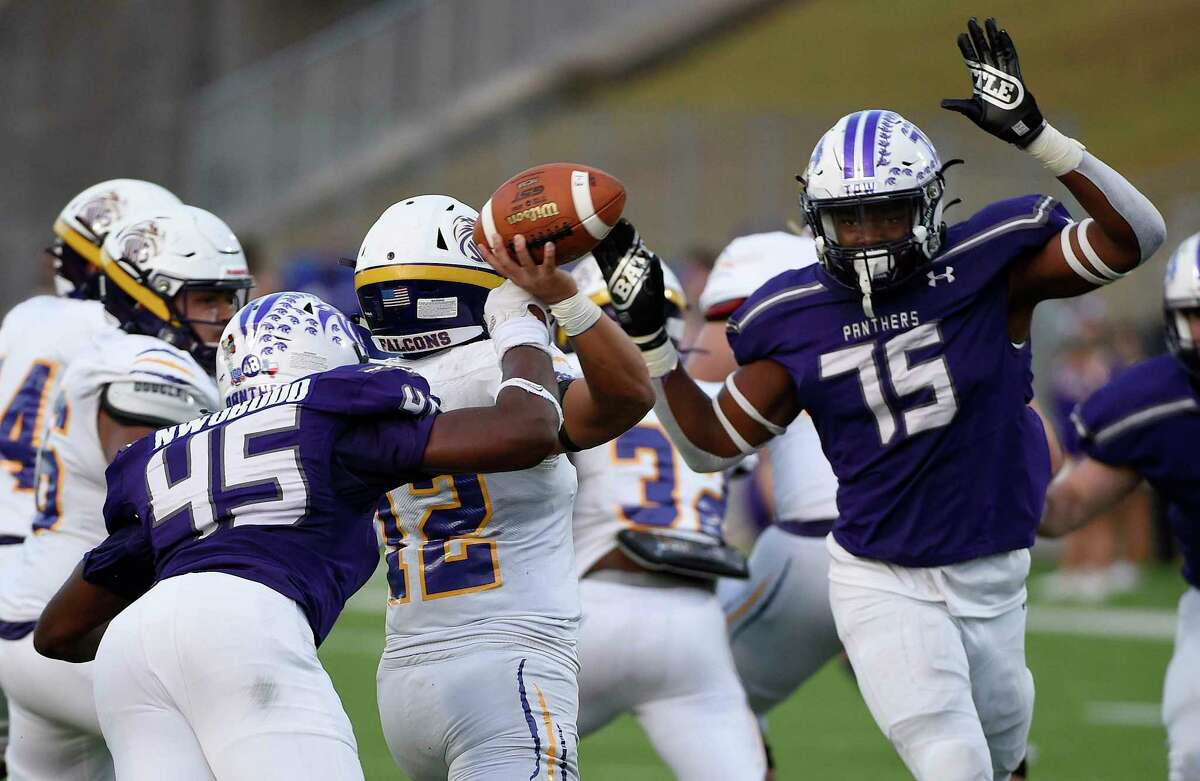 Jersey Village quarterback Adam Tran, second from left, attempts a pass as Ridge Point defensive lineman Jonathan Nwobodo (45) applies pressure during the first half of a 6A Division I Region II area round high school football playoff game, Saturday, Dec. 19, 2020, in Katy, TX.