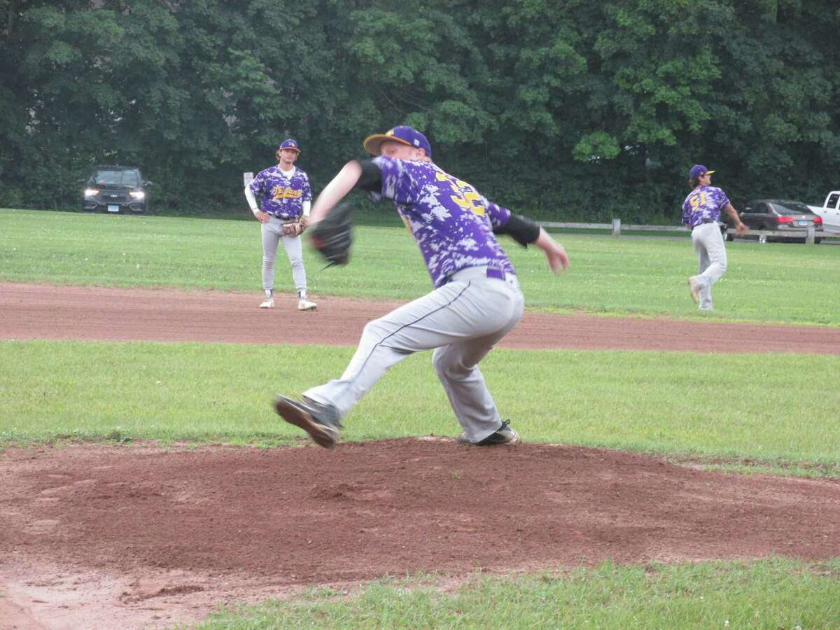 Veteran ace Miles Scribner warms up last Thursday for a game between his Tri-Town Trojans and the Amenia (N.Y.) Monarchs at Litchfield's Community Field.