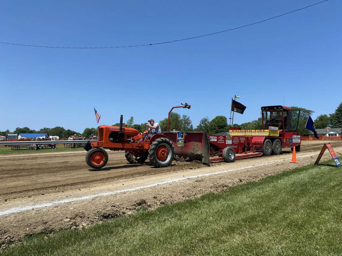 A participant drives his tractor during the Port Hope tractor pull July 3.