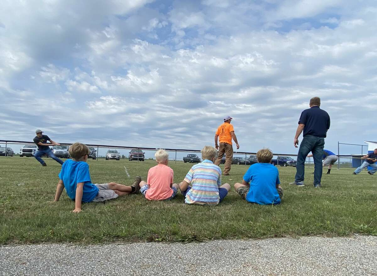Four boys watch a game of Tug O'War at the Port Hope Activity Center July 3.