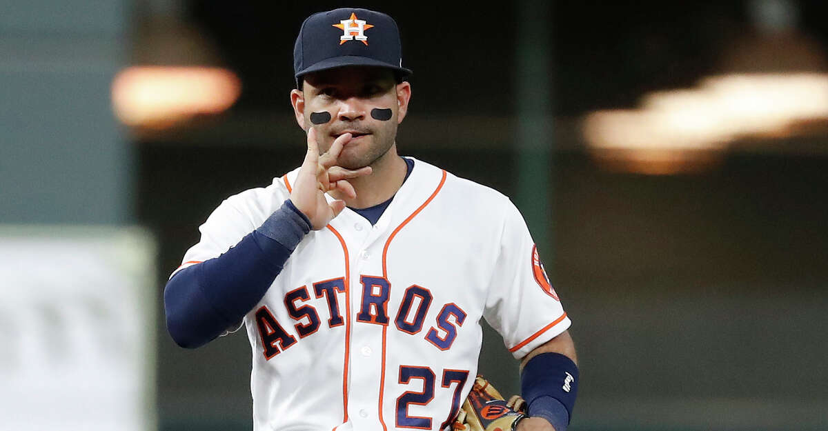 Houston Astros second baseman Jose Altuve (27) bites his nails during the fifth inning of an MLB baseball game at Minute Maid Park, Wednesday, June 30, 2021, in Houston.