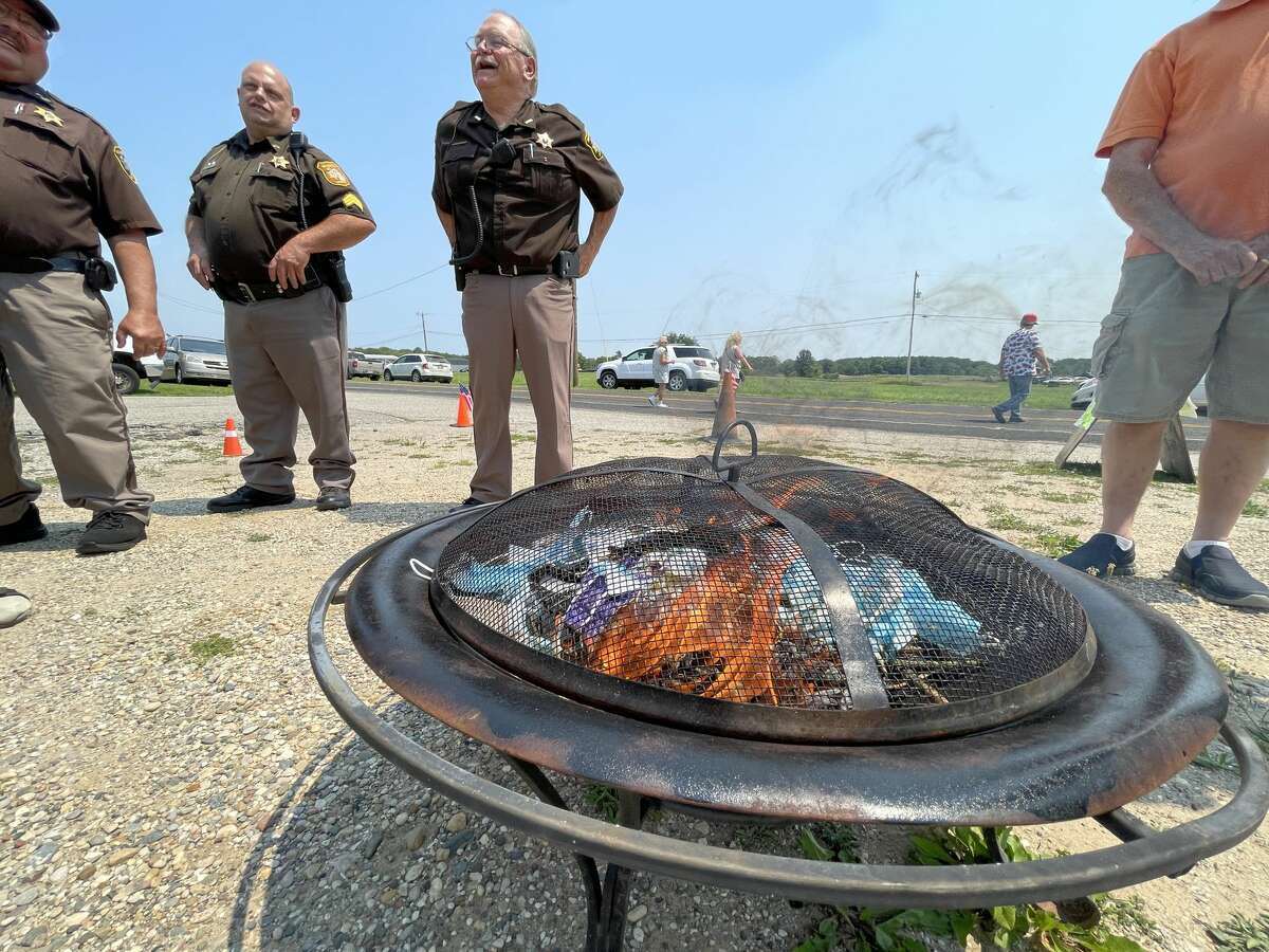 The Morley Community Center hosted a COVID-19 mask-burning party on Saturday. Prior to the burning, members of the Stanwood Lions Club honored Dan Deyo with a special plaque for 53 years of service with the Morley Area Fire Department.