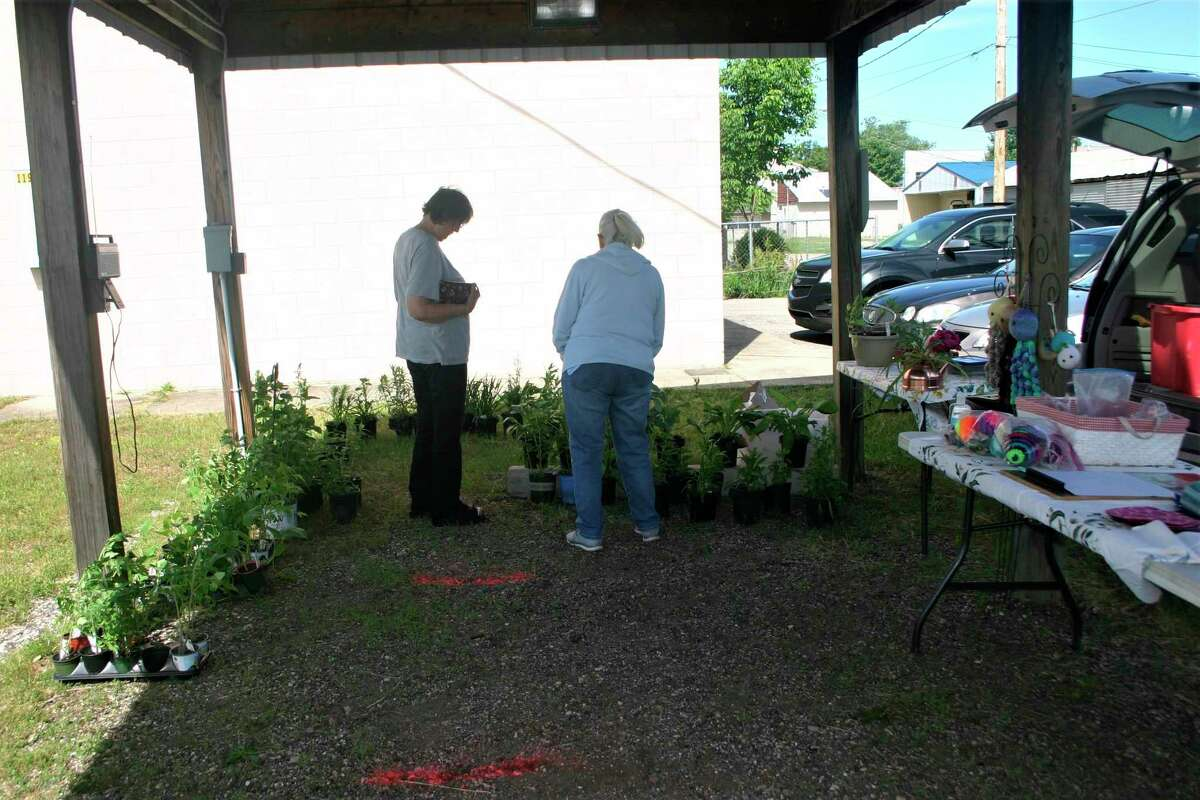 Because vendor space is limited at the current Reed City farmers market location on Chestnut Street, the Chamber would like to see it move the Depot area so more vendors can participate. (Herald Review file photo)