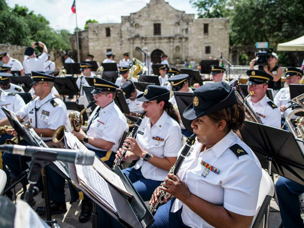 Sgt Rashada Smith, front right, a member of the 313th Army Band, warms up on the clarinet as the 323rd and 313th Army Bands played their Fourth of July concert in Alamo Plaza on Friday, July 2, 2021 in San Antonio, Tx., U.S.