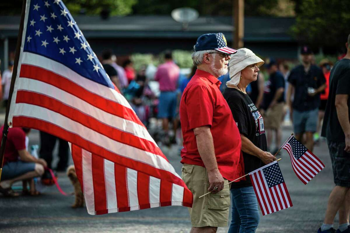 Community members prepare to hold the 25th annual Oak Park-Northwood Fourth of July Neighborhood Parade on Saturday, July 3, 2021, in San Antonio.