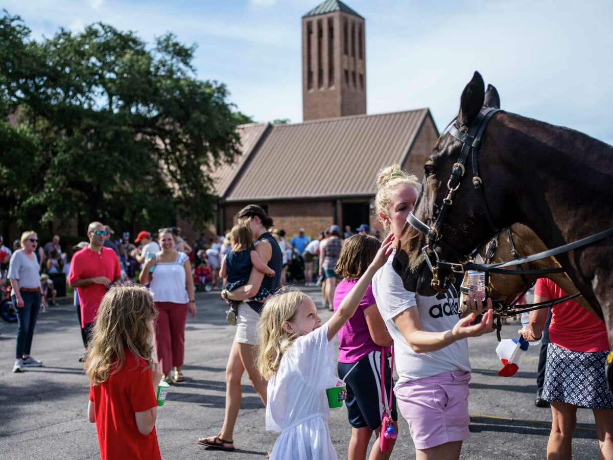 Community members start down the street during the Oak Park-Northwood parade celebrating the Fourth of July on Saturday, July 3, 2021. The parade started at the Northwood Presbyterian Church.