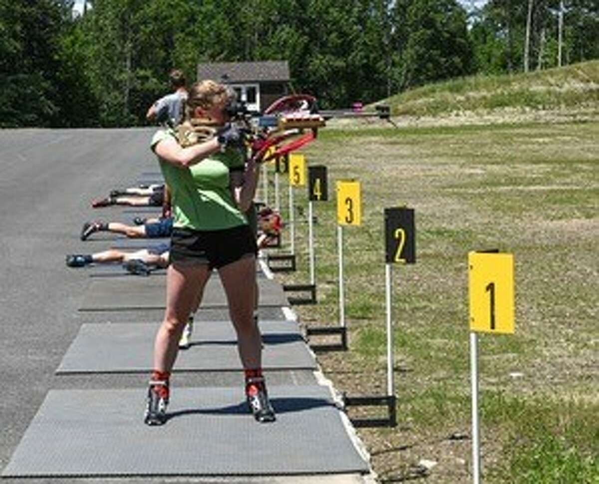 Emma Stertz of Grand Rapids, Minn., takes shots in the standing position at the new biathlon range at Mount Van Hoevenberg near Lake Placid. The Olympic Regional Development Authority has moved its biathlon venue from the ski jumping site to a much larger year-round facility.