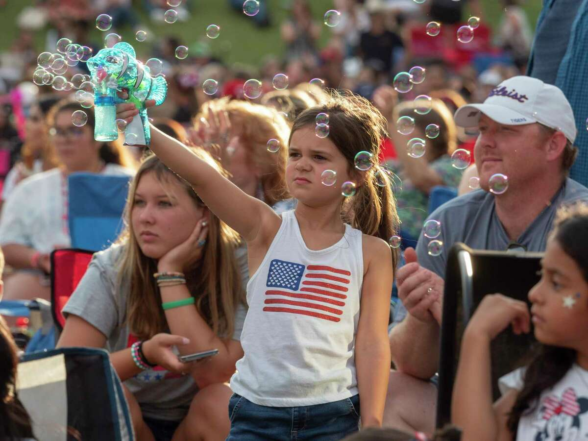 Families and friends fill the lawn area and walkways 07/03/2021 for the 2021 Star-Spangled Salute in Centennial Park. Tim Fischer/Reporter-Telegram