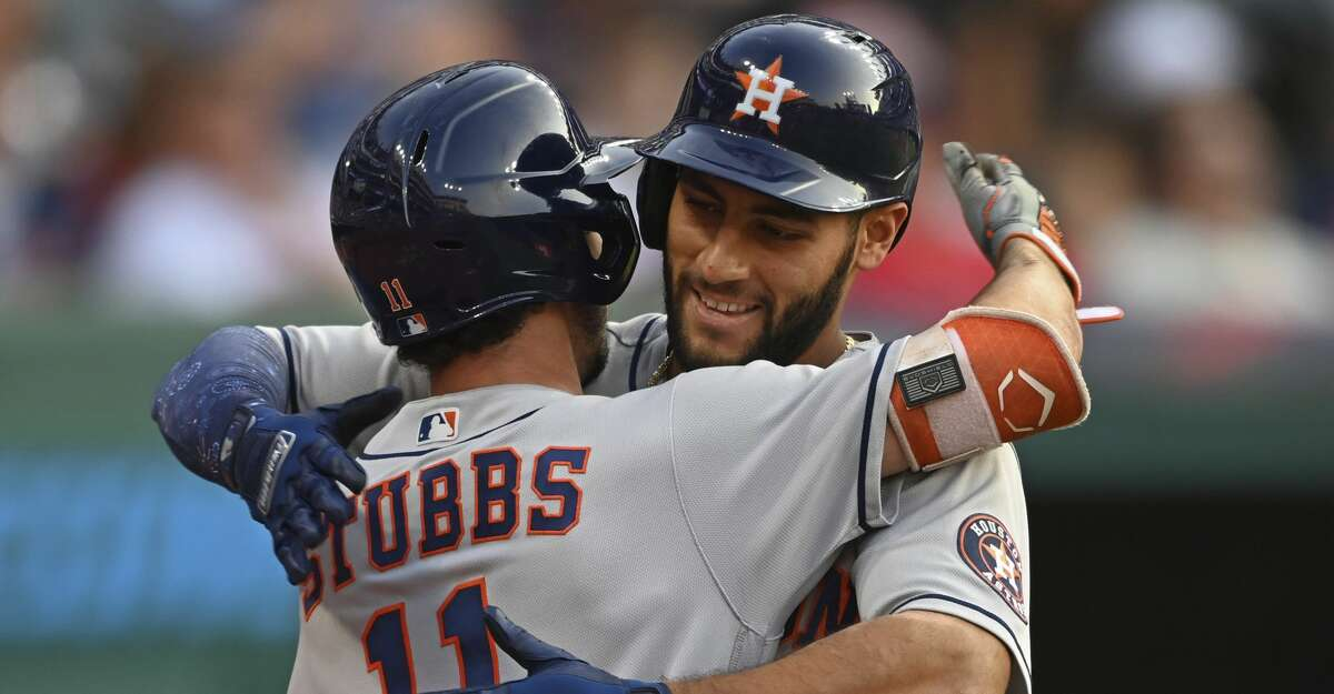 Houston Astros' Abraham Toro, right, is congratulated by teammate Garrett Stubbs after hitting a solo home run off Cleveland Indians starting pitcher Eli Morgan in the fourth inning of a baseball game Saturday, July 3, 2021, in Cleveland. (AP Photo/David Dermer)