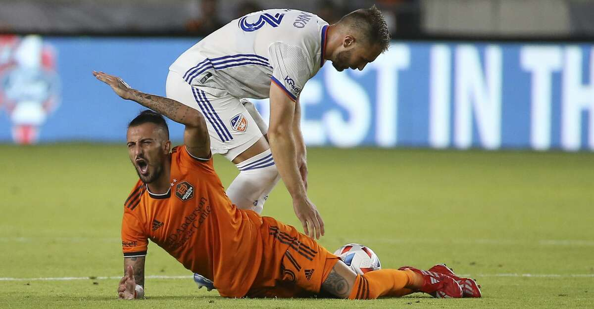 Houston Dynamo forward Maximiliano Urruti (37) calls to the referee after being brought down by FC Cincinnati midfielder Caleb Stanko (33) during the second half of the MLS match Saturday, July 3, 2021, at BBVA Stadium in Houston.