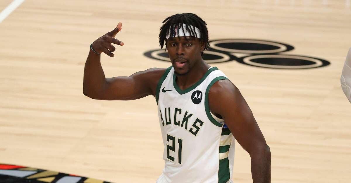 Jrue Holiday #21 of the Milwaukee Bucks celebrates a three point basket against the Atlanta Hawks during the second half in Game Six of the Eastern Conference Finals at State Farm Arena on July 03, 2021 in Atlanta, Georgia (Photo by Kevin C. Cox/Getty Images)