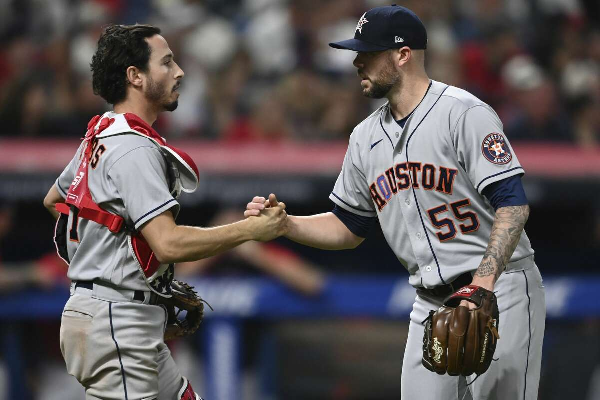 Houston Astros' Garrett Stubbs, left, congratulates relief pitcher Ryan Pressly after they defeated the Cleveland Indians in a baseball game Saturday, July 3, 2021, in Cleveland. (AP Photo/David Dermer)