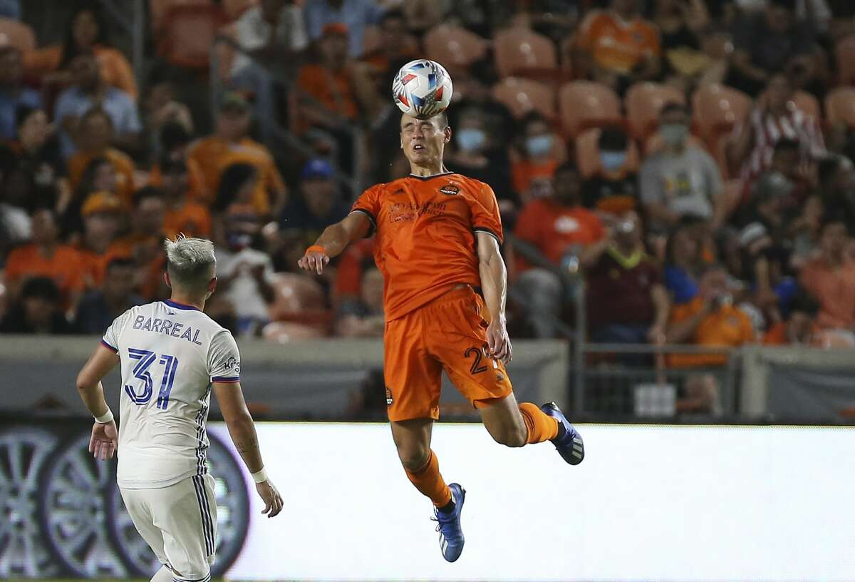Houston Dynamo defender Sam Junqua (29) goes up for a header during the second half of the MLS match Saturday, July 3, 2021, at BBVA Stadium in Houston.