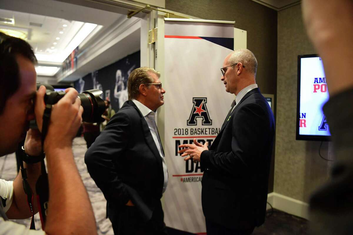 UConn women's basketball coach Geno Auriemma, left, talks with UConn men's basketball coach Dan Hurley during AAC Media Day at the Philadelphia Airport Marriott on Monday, Oct. 15, 2018.