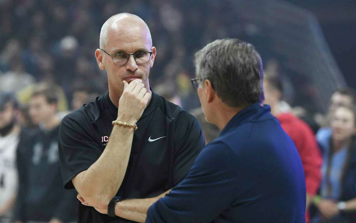 Connecticut men's head coach Dan Hurley, left, talks with women's head coach Geno Auriemma during UConn's men's and women's basketball teams annual First Night celebration in Storrs, Conn, Conn., Friday, Oct. 18, 2019, in Storrs, Conn.