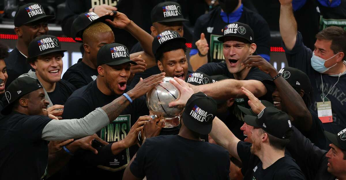 Members of the Milwaukee Bucks hold the Eastern Conference Finals trophy after defeating the Atlanta Hawks at State Farm Arena on July 03, 2021 in Atlanta, Georgia (Photo by Kevin C. Cox/Getty Images)