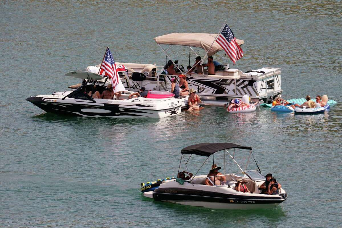 Boaters at Lake Berryessa's Pope Creek enjoy the Fourth of July weekend. The increase in visitors to the lake has meant more emergency calls for first responders.