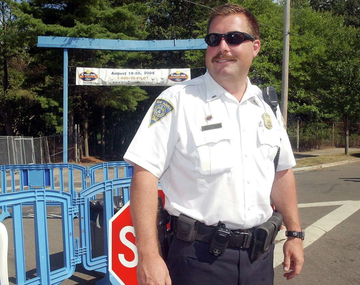 FILE PHOTO: Peter Reichard, a member of the New Haven Police Department in 2005 at the Pilot Pen Tennis tournament. New London's mayor says Reichard retired as his city's police chief when he was confronted about recorded comments he made about his time with the New Haven department.