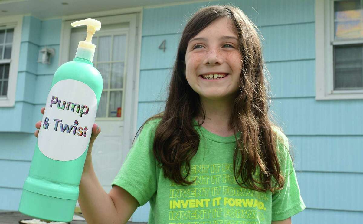 Skye Martin, 10, and her invention, the Pump and Twist, at her home Thursday, July 1, 2021, in Norwalk, Conn. Skye won the statewide and national invention convention and will participate virtually in the global convention with her shampoo bottle invention.