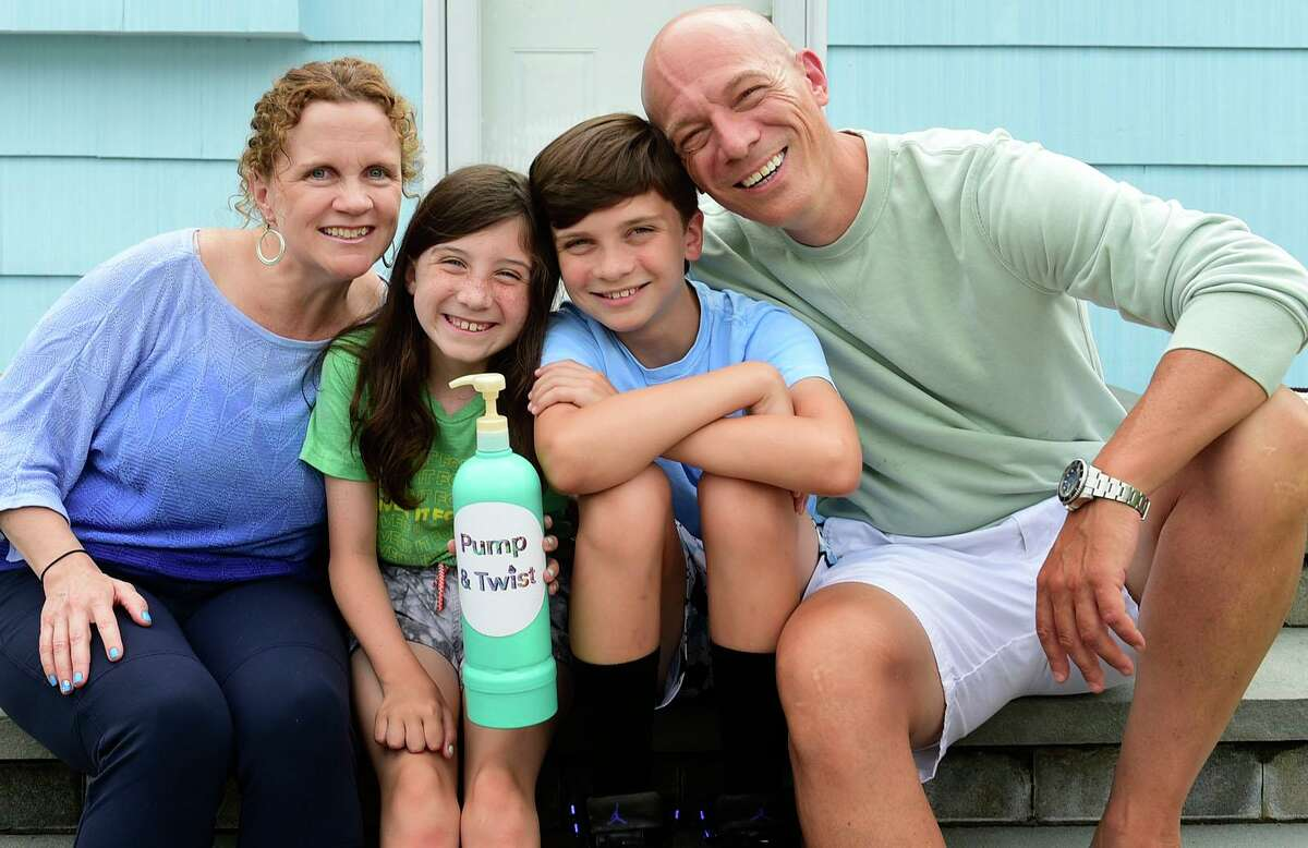 Skye Martin and her invention, the Pump and Twist, with her parents Nancy and Glenn and brother Hunter, 12, at their home Thursday, July 1, 2021, in Norwalk, Conn. Skye won the statewide and national invention convention and will participate virtually in the global convention with her shampoo bottle invention.
