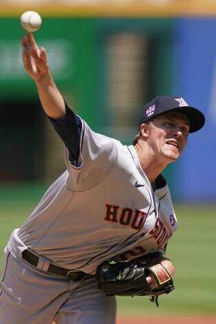 Houston Astros starting pitcher Zack Greinke delivers in the first inning of a baseball game against the Cleveland Indians, Sunday, July 4, 2021, in Cleveland. (AP Photo/Tony Dejak) Photo: Tony Dejak, Associated Press / Copyright 2021 The Associated Press. All rights reserved.