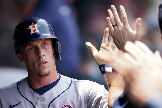 Houston Astros' Myles Straw is congratulated by teammates after scoring in the fourth inning of a baseball game against the Cleveland Indians, Sunday, July 4, 2021, in Cleveland. (AP Photo/Tony Dejak) Photo: Tony Dejak, Associated Press / Copyright 2021 The Associated Press. All rights reserved.