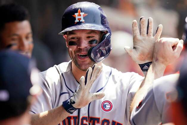 Houston Astros' Chas McCormick is congratulated by teammates after hitting a two-run home run in the sixth inning of a baseball game against the Cleveland Indians, Sunday, July 4, 2021, in Cleveland. (AP Photo/Tony Dejak) Photo: Tony Dejak, Associated Press / Copyright 2021 The Associated Press. All rights reserved.
