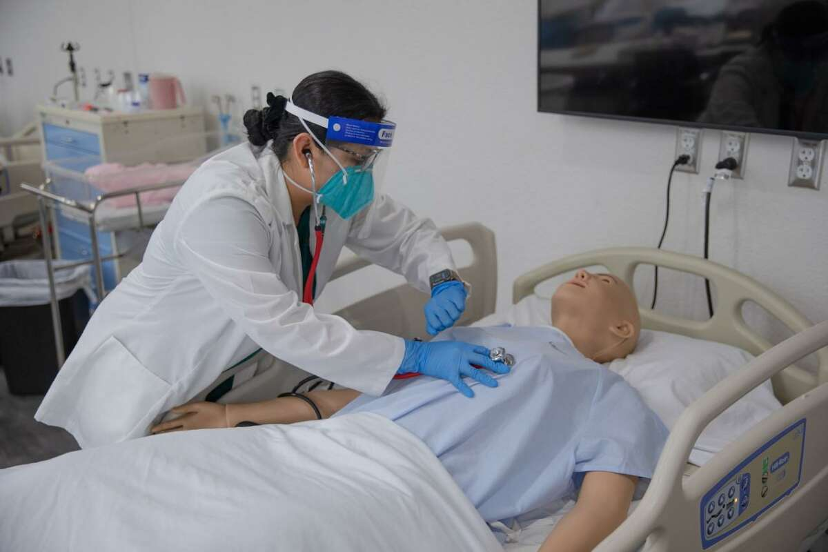 """A Laredo College nursing student practices on a dummy. LC was named at the top of the """"2021 Best Nursing Schools in Texas"""" list released by RegisteredNursing.org."""